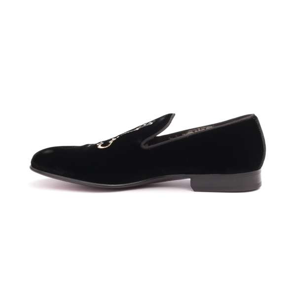 Black suede moccasin with key Insignia by Dolce and Gabbana