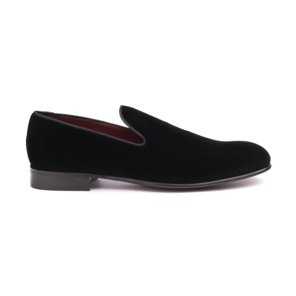 Black suede slip on by Dolce and Gabbana